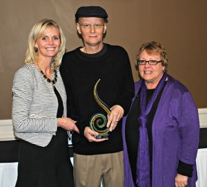 Brad receiving the Be the One award from the Heartland United Way with his wife Jeannee (right).